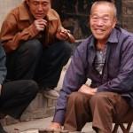 Menschen in Pingyao (beim Spiel, auf dem Markt und den Gassen)