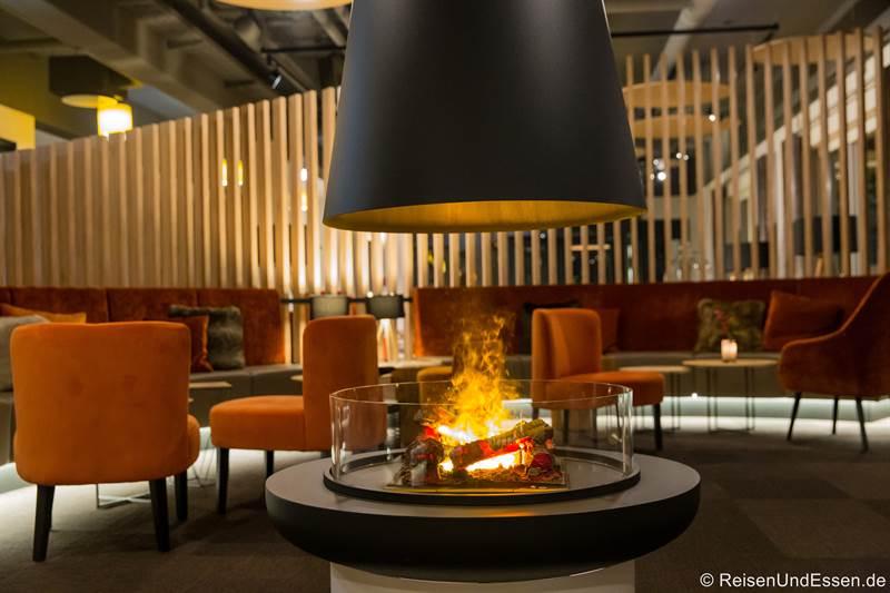 Kamin in der Lounge im Sonnenhotel Weingut Römmert in Volkach